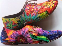 I love the almost abstract flowers in these shoes. The bright colors and the painted style in the design really give these shoes a unique personality.