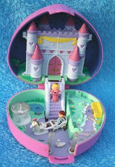 Polly Pockets, back when they were actually pocket-sized!! :) Ultra collectible and stimulating for the imagination. This heart castle one was very popular; my sister had it, and now my kids can play with it. :D