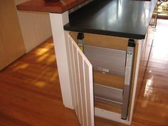 Folding flat step stool hidden in end of cabinet