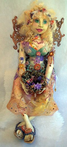 Her name is Solara.  Made from a  Patti Medaris Culea pattern in her class.  Pattern is the cover doll from the Creative Cloth Doll a beading book.