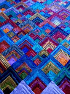 """""""Yikes Stripes"""" quilt, esigned and pieced by Judith Ackerman, inspired by a quilt by Kaffe Fassett and quilted by Andrew Sas"""