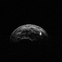 Animation of asteroid 2004 BL86 constructed from radar images made by the Green Bank Telescope from radar transmitted from NASA's Goldstone Deep Space Network antenna. It reveals clear surface features and the motion of a companion moon-like body. Credit: NASA/JPL-Caltech; NRAO/AUI/NSF