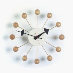 For people with a rather classic understanding of design, this wooden version of the Ball Clock might be right one.