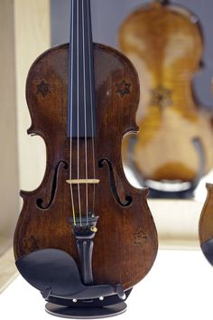 In this April 9, 2012 photo, a violin with five Stars of David is shown on display at the Violins of Hope exhibit at the University of North Carolina in Charlotte, N.C. Eighteen violins recovered from the Holocaust and restored by Israeli violin maker Amnon Weinsten make their U.S. debut on Sunday, April 15. Some were played by Jewish prisoners in Nazi concentration camps, while others belonged to the Jewish Klezmer musical culture. (AP Photo/Chuck Burton)