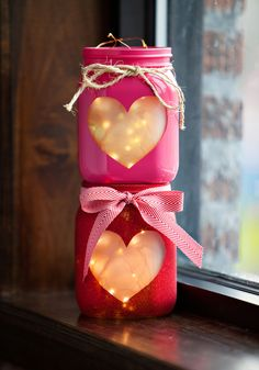 Valentine's Day Heart Jars.  The little wire lights are amazing, but I think these would look pretty with a tea light or flameless candle.