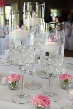 Beautiful tall candle centerpieces with pink flowers Candle Centerpieces, Floral Centerpieces, Wedding Centerpieces, Flower Arrangements, Wedding Decorations, Centrepieces, Pink Silver Weddings, Wedding Table Deco, Floating Candles