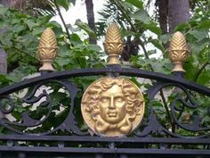 Close-up view of the intricate artwork on the gates to Miami Beach's Versace Mansion