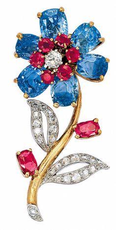 a0e259b1f14 A Retro Sapphire, Ruby and Diamond Brooch, Cartier, circa 1940. Stevie ·  Brooches