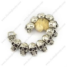 b003963 Item No. : b003963 Market Price : US$ 110.60 Sales Price : US$ 11.06 Category : Skull Bracelet