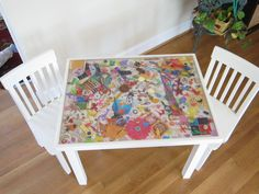 Kid's school auction project - epoxy filled i-spy table.  Each child brought in various things to include in the table and they were embedded in epoxy to create a 3-D appearance.