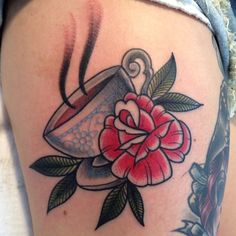 "Teacup tattoo. Love the placement of the flower - I would like to get something like this along with the saying ""She's whiskey in a teacup."" The teacup would have to be tilted and look like it is full of whiskey."
