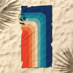 This retro towel is a colorful way to keep your body + belongings sand-free.