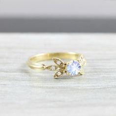 Moonstone and diamond engagement solitaire nature inspired leaf ring in gold handmade