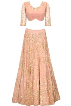 Peach sequins and beads embroidered lehenga set by Astha Narang. Shop at: http://www.perniaspopupshop.com/designers/astha-narang #lehenga #clothing #asthanarang #perniaspopupshop #shopnow