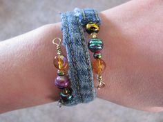 """Memory wire denim bracelet ~ used the """"butt"""" seam of an old pair of jeans . Just feed the wire through the middle & add beads to the end. Fabric Beads, Fabric Jewelry, Boho Jewelry, Jewelry Crafts, Beaded Jewelry, Jewelry Design, Memory Wire Bracelets, Jewelry Bracelets, Jewelery"""