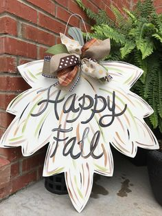 Wood Leaf Door Hanger. Measures 24. Ribbon may vary due to availability. **Shipping charges cover USPS Ground Transportation (2-9 days). In some cases, these charges will cover Priority Shipping (2-3 days) depending on your postal zone. If you are concerned with shipping time, please convo