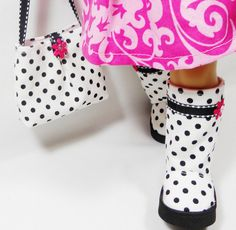 """White and black polka dots boots set designed for your 18"""" American Girl dolls! They have velcro fasteners in the back and black foam outer soles. The interior is lined. These boots are well constructed with great focus on craftsmanship. The purse is fully lined with white fabric and closes with velcro. Front and back have inverted pleats and decorated with magenta pink flowers. American Girl 18 Dolls Purse and Boots Set  White by MegOrisDolls,"""