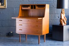 Danish Teak Secretary Just discovered this amazing retro rehab furniture retailer in Minneapolis.  I'm in love with all of their pieces!