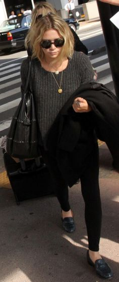 Ashley Olsen - scruffy bob, oversized sweater, skinny jeans and loafers
