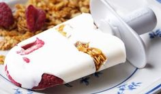 FROZEN YOGURT BREAKFAST POPS 2 cups 2% Greek Yogurt 2 tablespoons honey 1 cup fresh berries 1 cup granola Whisk together the yogurt and honey. Pour into Popsicle Molds or small paper cups. Drop a few berries and a tablespoon of granola into each popsicle. Push the goodies down with a chopstick or the tip of a knife. Insert popsicle sticks. Freeze until solid. Grab and Go for breakfast!