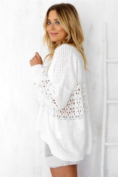 Stay warm with the Tamia White Knit, featuring a high neckline, a loose weave knit and hole panel detailing throughout. Oversized boxy fit. Asymmetric hemline, ribbed cuffs and hem. Can be worn as a top or a jumper. By Sabo Skirt.