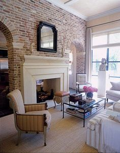 Elegant living room with brick wall and double sided fireplace