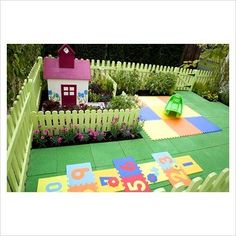 "PLAYGROUND TILES -- Create an adorable ""children's garden"" in your backyard.  A little extra cushion for little legs."