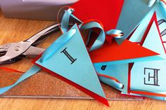 Use a template in main color with accent color behind the letter.  Great way to customize party favors on a budget !