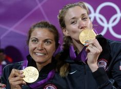 US volleyball players Missy May Treanor and Kerri Walsh Jennings show their gold medals some love