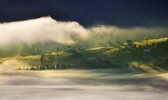 22 Dreamy Photos Capture Polish and Italian Mountain Villages Engulfed in Mist