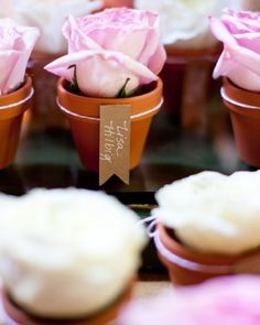 Blooming Escort Cards  Single roses in mini terracotta pots had paper flags calligraphed with guests' names to guide them to their seats.