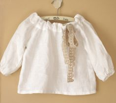 Robe of Feathers white linen top