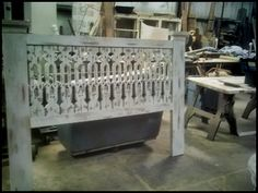 Headboard made from salvaged exterior pilasters and porch railing!