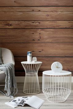 Transform your home into a cabin retreat with this wood wallpaper. Rustic wooden planks give your living room spaces a lovely warmth. Pair with white furnishings for a winter wonderland feel.
