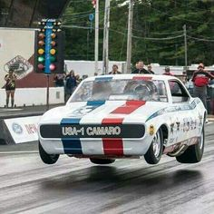 Bruce Larson is LITERALLY flying high again in his 1968 Chevy Camaro, showing us an amazing feat of levitation at the 2013 NHRA New England Hot Rod Reunion. Nhra Drag Racing, Old Race Cars, Automobile, Vintage Race Car, Drag Cars, Car Humor, Car Memes, Chevrolet Camaro, 1968 Camaro