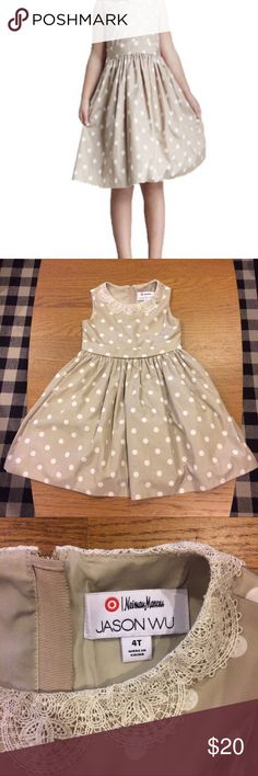 Neiman Marcus for Target Polka-Dot Dress ||Size 4T Jason Wu Neiman Marcus for Target Little Girl Polka-Dot Dress ||Size 4T|| Beautiful round neckline contrast with scalloped lace trim.  Sleeveless. Easy to put on with golden zipper on the back and bow with snap button. 100% Polyester and 100% Mesh lining Nylon. Perfect flare and true to size. My kid put it on once for a wedding. No stains. Like new! ✨ Neiman Marcus Dresses Formal
