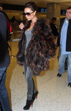 Victoria Beckham, wearing a fur coat at the Carlyle Hotel. Victoria paired her suede black Christian Louboutin ankle boots with a grey pair of skinny jeans for a sexy winter look.  (February 17, 2010 - Source: Bauer Griffin)