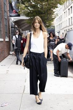 Shop this look on Lookastic: http://lookastic.com/women/looks/white-tank-black-crossbody-bag-black-culottes-black-ballerina-shoes/10989 — White Tank — Black Leather Crossbody Bag — Black Culottes — Black Leather Ballerina Shoes