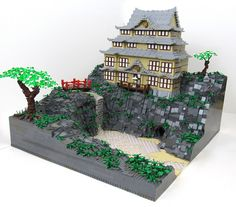 Water/sandy beach/rock base and a Japanese-inspired temple.  Um, what could be more awesome?