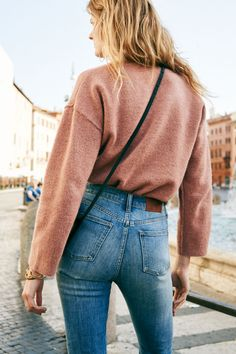 madewell perfect fall jean + connection sweater in sunset rose worn by our muse constance jablonski in our fall catalog shot in rome. #everydaymadewell to pre-order, call 866-544-1037.