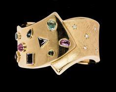 BRACELET, gold with tourmalines, amethyst, sapphire etc and brillant cut diamonds