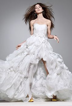 Brides.com: 10 Unforgettable Wedding Gowns. Play with the dichotomy of a full skirt and a risqué high slit in this silk-chiffon and embroidered silk-organza strapless ball gown. Dress, $10,790, Monique Lhuillier. Earrings and bracelet, Mimi So. Shoes, Christian Louboutin.  Try on this dress in our virtual Dressing Room.