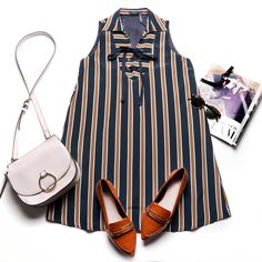 Love the trendy lace-up detail paired with a classic A-line silhouette and the camel and navy stripes! Modern and grunge inspired.