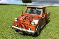 This is a custom-built wooden pickup truck. It lives in Virginia, it's made of wild cherry, and it's up for sale on eBay with current bidding quite low.
