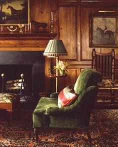 green velvet chair, equestrian paintings, warm paneling - Anne Miller Interiors