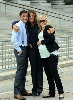 Group shot: Mariska giddishly smiles between her SVU co-stars Kelly Giddish and Raul Esparza