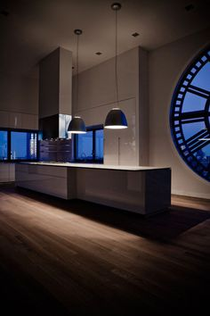 Minimal designed this stunning kitchen inside a Clock Tower apartment in New York City, USA. Be it night or day, the effect of the clock window on its interior is striking, and the kitchen's design more than reaches the standard for design and aesthetic.  Via HomeDSGN