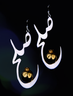 """Maintain an air of peace with these dangling silver earrings! Silver bells sit inside the words """"peace"""", written in Persian.!!    Stand out from the crowd    Made with 999 silver 18k gold plated    Copyright Nazanin Alaei 2012 (Nazz Gallery) All Rights Reserved    $140"""