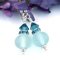 Given a perfect name, the SOFTLY SAPPHIRE handmade lampwork and sterling earrings are fun, flirty and feminine - and for the woman who adores several shades of blue in one design.