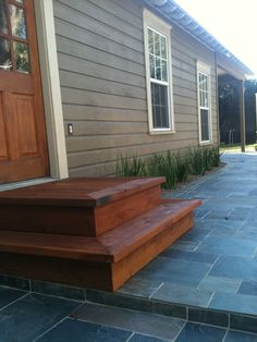Western Red Cedar Steps leading to the house create a simple but Rustic feel to this patio.  The steps were built by the Western Patio Company, located in Spring, Texas.  WPC is a Rustic Outdoor Living Contractor who specializes in Rustic Designs and Construction.